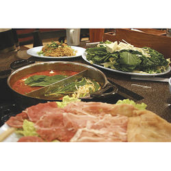 Gathering around a hot pot is a great way to spend a cool evening.
