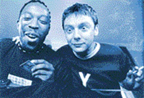 Stark raving mad: Koop (Shaun Parkes, left) and Jip (John Simm) seek relief  from their working-class existence via sex, drugs and rave music