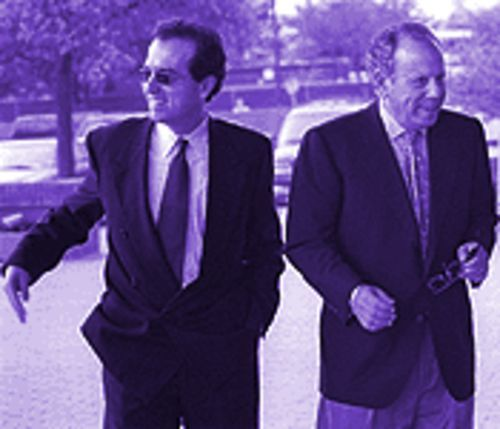 Laughing all the way to the bank: George Postolos (left) and Les Alexander