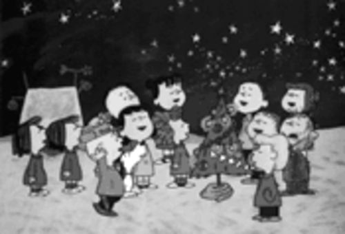 "Sleigh bells in the air, beauty everywhere: a scene from A Charlie Brown Christmas. Little-known fact: In 1990, director John Hughes talked to Charles Schultz about making a live-action version of the holiday special. ""It will never happen,"" says Lee Mendelson. ""Oh, God, no."""