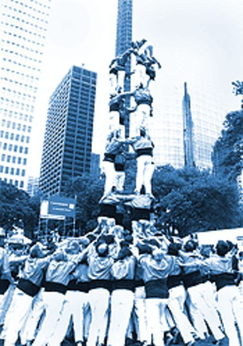 "Bayousphere With a slight lean: ""Italian villagers"" make a human tower at the International Festival."