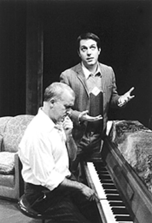 Robert Leeds (seated) plays the washed-up songwriter, and Ryan Leach plays the wanna-be.