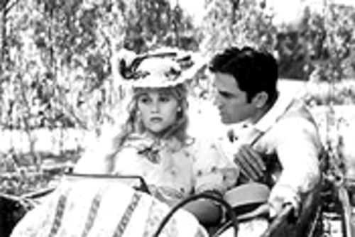 Reese Witherspoon speaks veddy good English to Rupert Everett in Oscar Wilde's classy freak show.