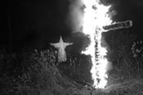 "The ""softer, kinder"" KKK lights up a cross."