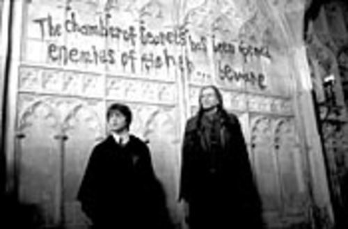 The writing's on the wall: There's danger afoot again for Harry (Daniel Radcliffe) at Hogwarts.