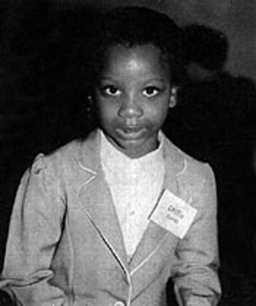 Cecilia, shown at a young age, grew up in the Chicago  projects.