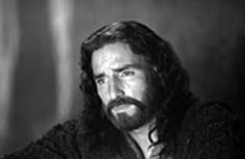 Jim Caviezel, who always looks like he's suffering  anyway, plays Jesus.