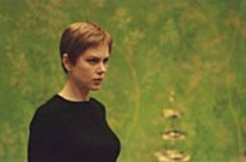 Nicole Kidman plays a would-be pedophile in Mia Farrow's 1960s hairdo.