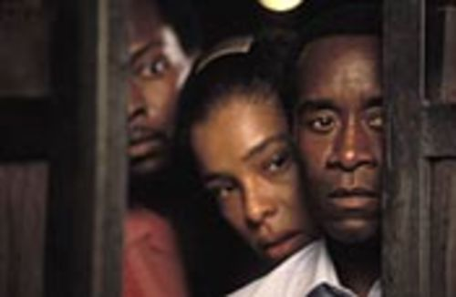 Don Cheadle (right, with Sophie Okonedo and Antonio  Llyons) plays a Hutu hotel manager who helps the  Tutsis.