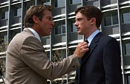 Carter (Topher Grace, right) may be the boss, but Dan  (Dennis Quaid) has what he wants.