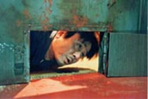 Trapped in a seedy motel room for years, Dae-su  (Choi Min-sik) tries to stave off insanity.