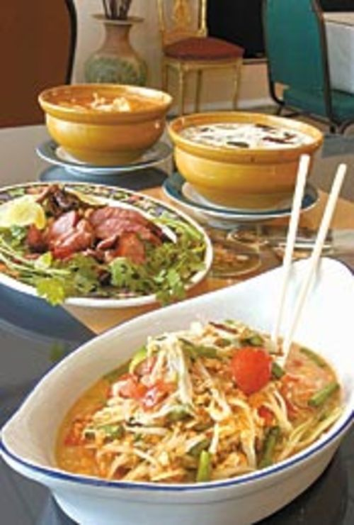 In Laotian som tum (front, pictured with E-sarn  sausage, massaman curry and tom kha  gai), crab exoskeleton is mixed in with papaya  salad.