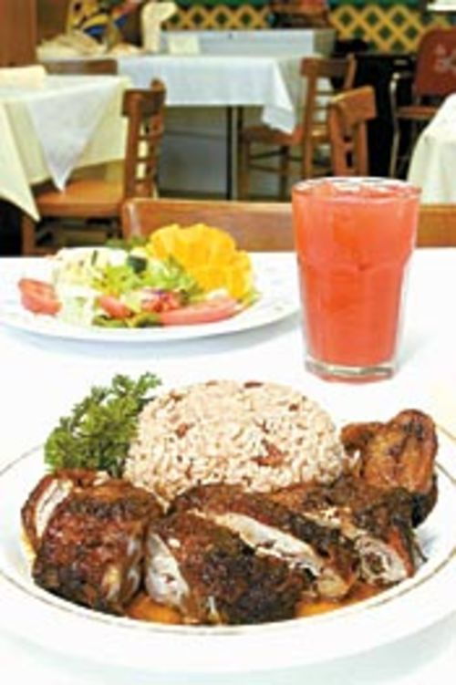 When Tropical Grill's jerk chicken is wood-smoked, it's  sensational.
