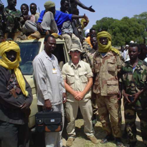 Marine-turned-activist Brian Steidle stands with a rebel group in Darfur.