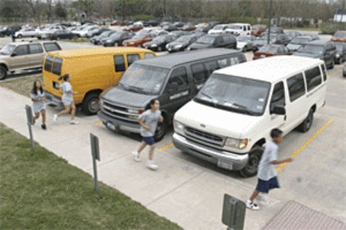 Lacking an indoor gymnasium, students at YES College Prep run laps in the school parking lot.