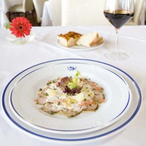 Veal with creamy tuna, anchovy and mayonnaise sauce sounds bizarre but tastes wonderful.