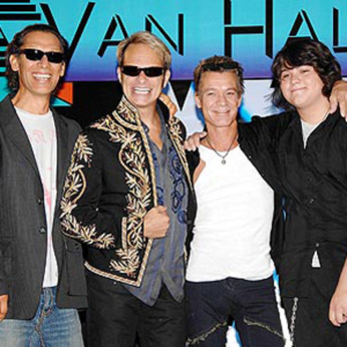 Eat 'em and Smile: Van Halen make nice for the cameras at last summer's press conference announcing their tour.