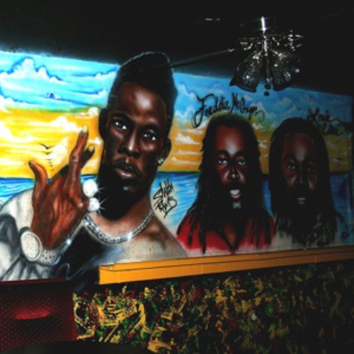 Club Riddims' mural is a roll call of reggae royalty.