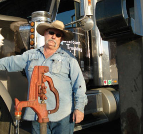 Bubba Melzer, an independent trucker from Crosby, has lost about half his income due to high diesel prices.