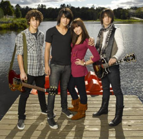 If you want to be a tweener Disney star, it doesn't hurt to get to know the Jonas Brothers, Kevin, Joe and Nick, shown here with Camp Rock co-star Demi Lovato.