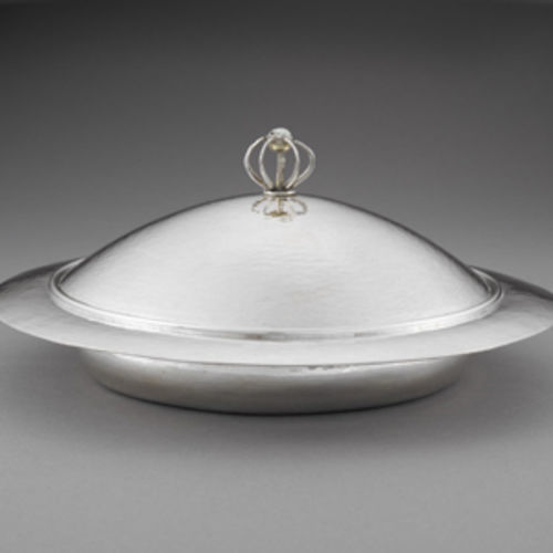 Charles Robert Ashbee's muffin dish is seemingly almost spun from silver.