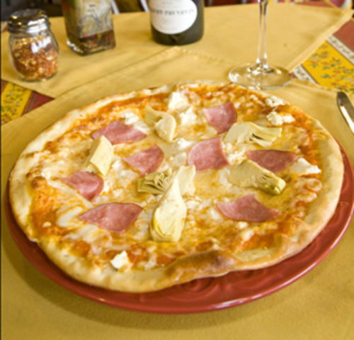 The pizza, with goat cheese, Bayonne ham and artichoke hearts, is a good deal.
