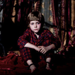 Shortly after the move to a new house, one boy (Ty Simpkins) falls into a coma.