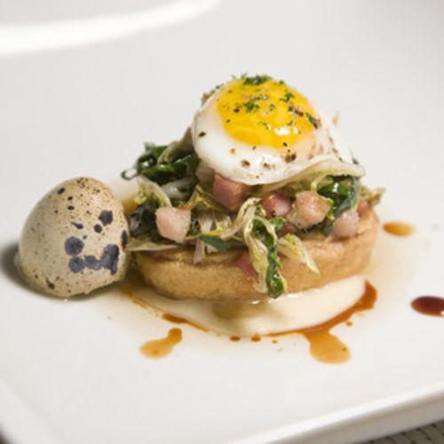 A standout is the vibrant bacon tart with a quail egg on top.