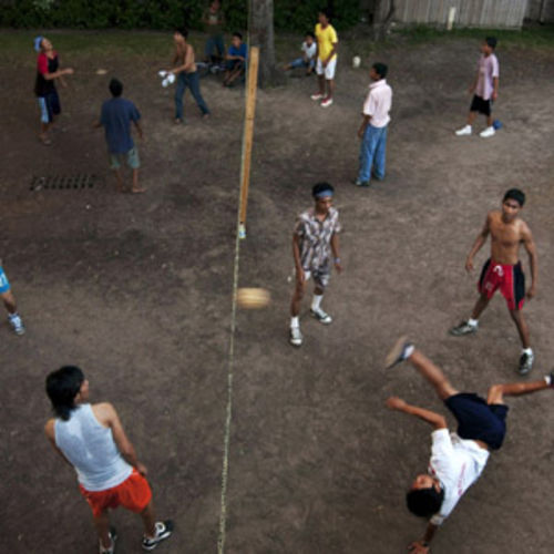 Chinlone, in which players kick a small ball made from dried palms over a net, is one of the most popular sports in Burma and other parts of Southeast Asia.