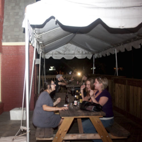 Rachael DeBlanc (left) and friends catch up on Cecil's patio.