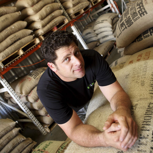 Avi Katz has green coffee beans from 20 different countries in his plant on 34th Street.