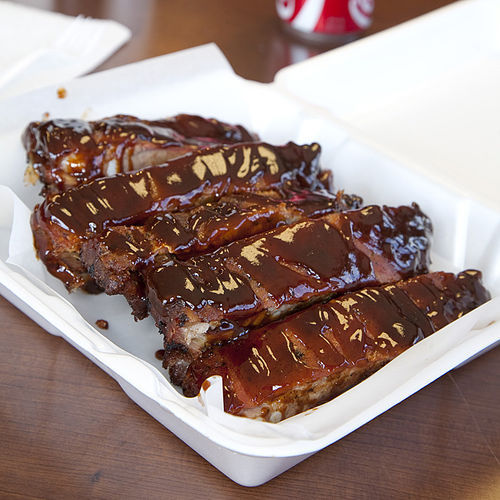 "The ribs come covered in one of the owner's ""signature sauces."""