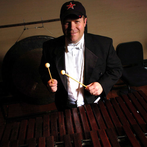 Mark Griffith, a percussionist for the Houston Symphony, sprinted from Jones Hall to Minute Maid Park in a tuxedo to catch the last innings of  the marathon playoff win over the Braves.