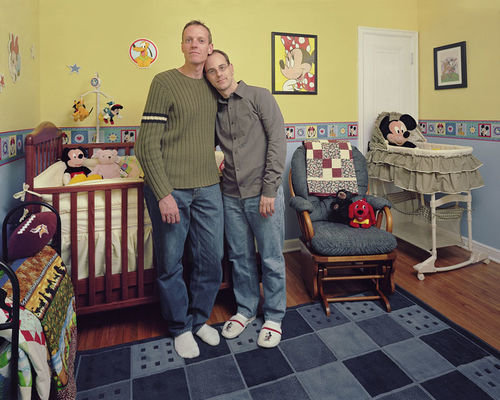 Expectant parents stand in the room they have prepared for their baby in Jason and Kevin, 7 days, 2007.