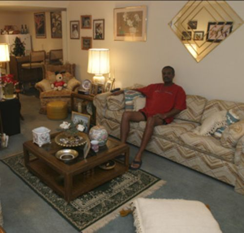 Marvin Evans relaxes in the apartment he has shared with his mother for 16 years.