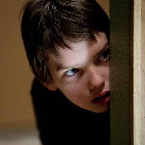 Owen (Kodi Smit-McPhee) spies on a potential playmate.