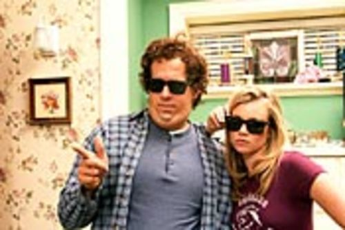 "Chris (Ryan Reynolds) and the girl he was once ""just  friends"" with, Jamie Palamino (Amy Smart)."