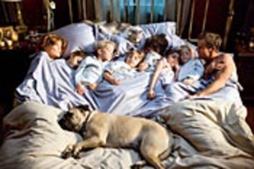 Bedtime is no time for newlyweds Frank (Dennis  Quaid, right) and Helen (Rene Russo, left) to get some  time alone -- not with six of their 18 kids between  them.