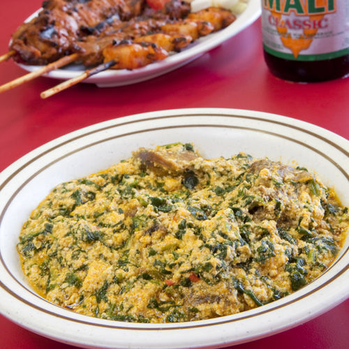 Spend a leisurely afternoon eating egusi soup and kebabs and drinking beer.