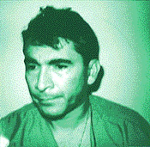 """The doctor"": Even in his mug shot, Carlos Chaves looked the part."