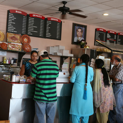 Customers line up at Raja, which was the first Indian sweet shop in Houston. The sweets are still made fresh here every day, even after 25 years.
