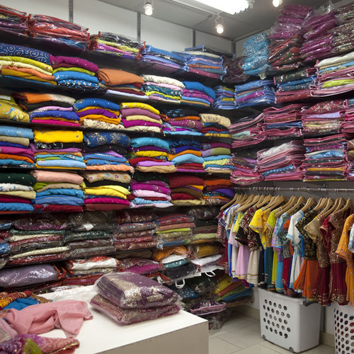 Colorful saris and vibrant fabrics are a common sight in the Mahatma Gandhi District, where sari shops were just as instrumental as Raja Sweets and Karat 22 in spurring growth.