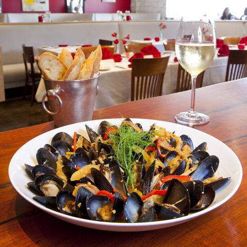 Café Moustache should focus on dishes like the mussels Provençal with chorizo.