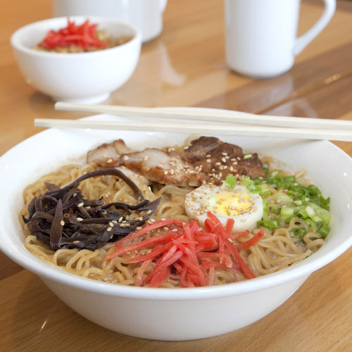 Think of tonkotsu ramen as the Japanese version of pho.