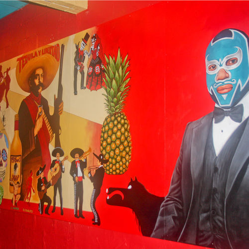 A masked luchador welcomes you to El Gran Malo.