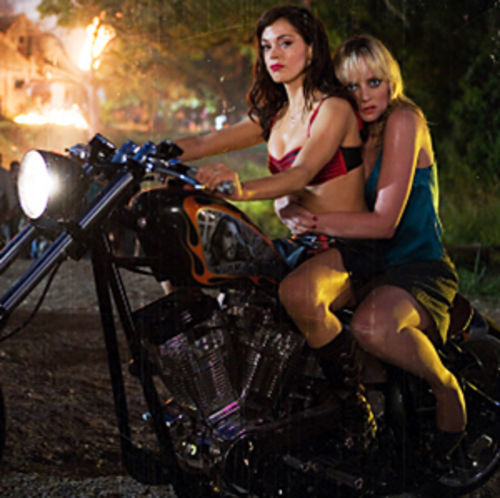 Robert Rodriguez's Planet Terror (with Rose McGowan and Marley Shelton) is a 90-minute jolt of zombie mayhem.