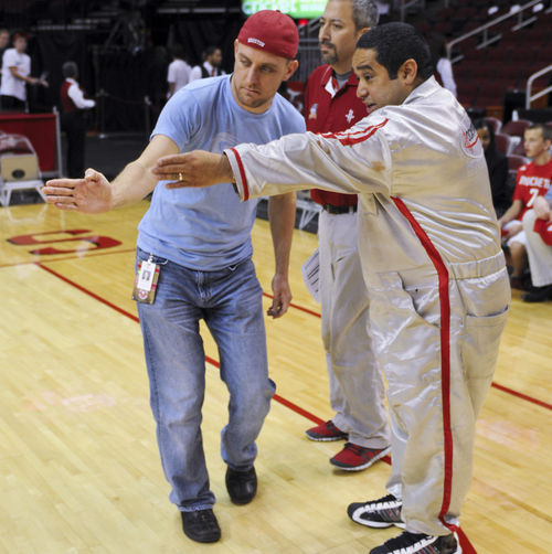 Boudwin (left) and his assistants, Mike Gonzales (middle) and Dominic Davila (right), plot out a stunt on the floor of the Toyota Center.