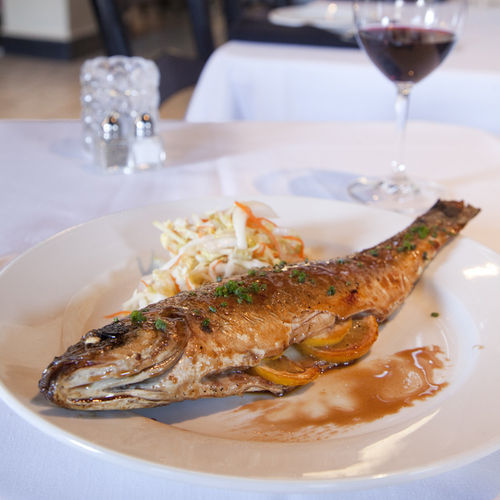 Perfectly cooked bronzino is fileted tableside.