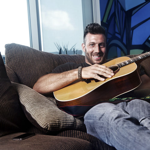 Houston Texans linebacker Connor Barwin relaxes in his downtown apartment with his father's old acoustic guitar. Don't worry; he's not quitting sacking QBs for the coffeehouse circuit.