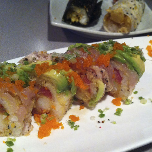 The 420 roll features shrimp tempura, spicy tuna and avocado.